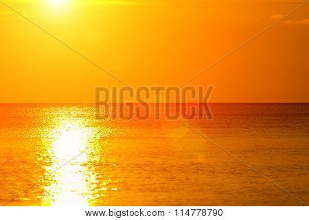 Ocean / sea horizon with sun flare.