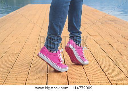 Girl walking on wooden boards.