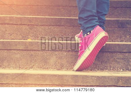 Girl walking up the stairs.