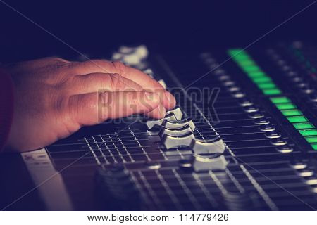 Detail of hand mixing the sound.