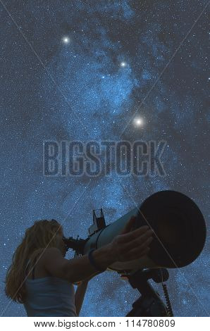 Stargazing through a telescope.