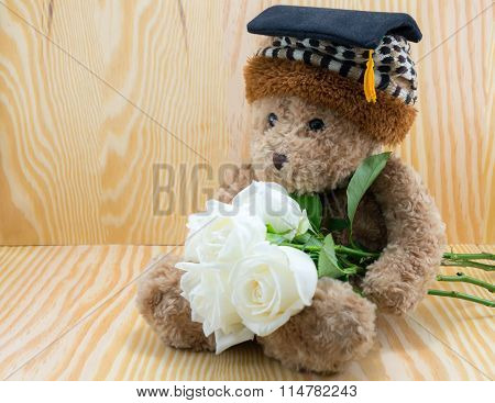 Brown Bear With White Roses Flower Of Love On Wood Background