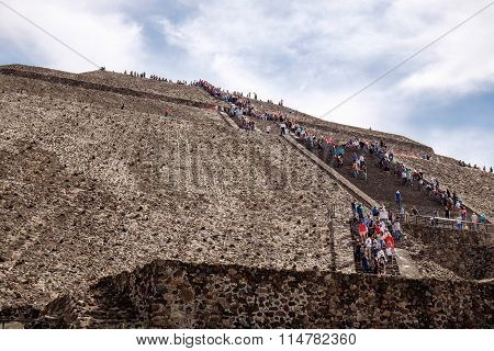 Teotihuacan, Mexico - 28 December 2015: People Climb The Stairs On Teotihuacan Pyramid Near Mexico C