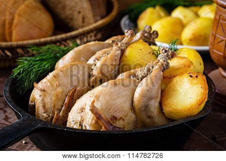 Crispy fried roasted chicken and golden potatoes, dinner meal