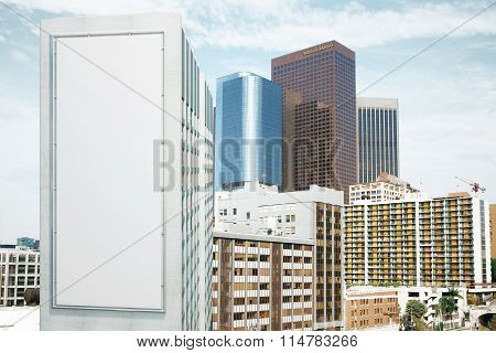 Blank White Billboard On The Wall Of High Building At Megapolis City Background, Mock Up