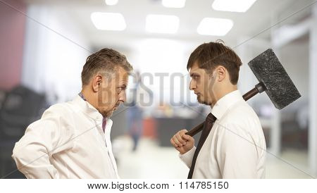 Business conflict concept. Two businessman are trying to come to an agreement