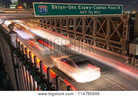 Cars Speeding On The Brooklyn Bridge From Manhattan To Brooklyn in New York City