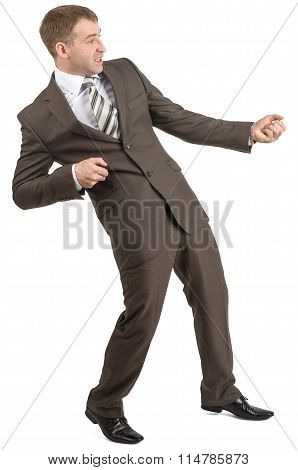 Businessman pulling invisible rope