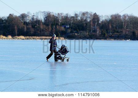 Woman And Pram On Ice
