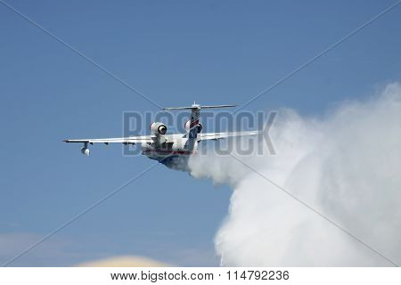 Seaplane Firefighter Dropping Water