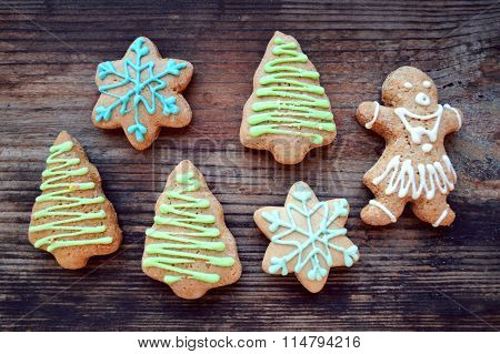 Gingerbread cookies in shapes of Christmas tree, snowflake and ginger man