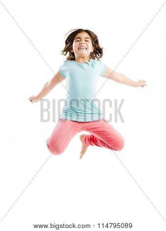 Beautiful and happy young girl jumping