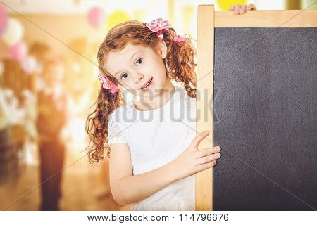 School Girl Holding Blank Blackboard. Education Concept.