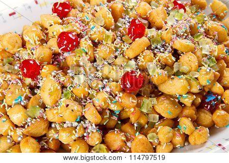 traditional italian christmas sweet struffoli on dish