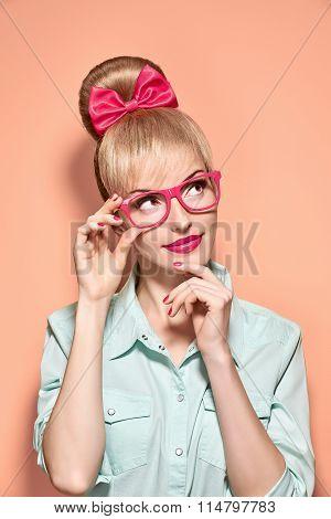 Beauty fashion nerdy woman thinking, glasses.Pinup