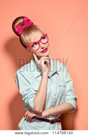 Beauty fashion nerdy woman thinking, glasses.Pinup