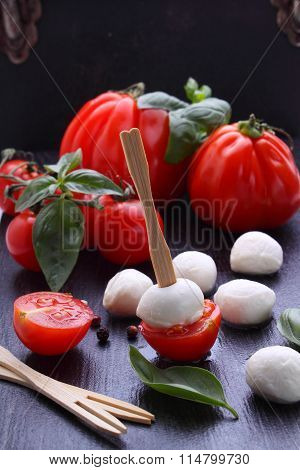 Appetizer Mozzarella On Skewers With Cherry Tomatoes And Basil