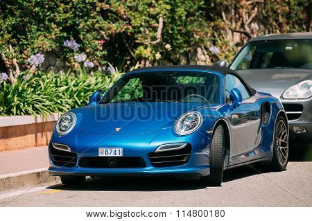 Blue color Porsche 911 Turbo S 2014 on street of Monte Carlo, Monaco