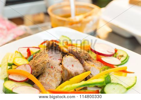 Delicious flank steak cuts cooked to perfection, mixed with reddish, zucchini and capsicum