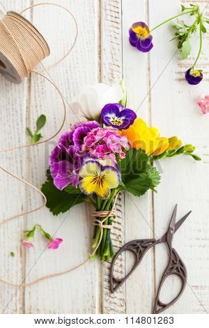 Beautiful bunch of flowers on the wooden table