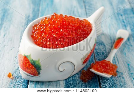 Red Salmon Caviar On A Blue Wooden Background