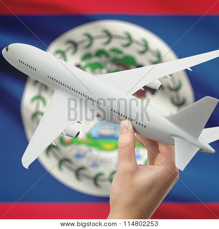 Airplane In Hand With Flag On Background - Belize