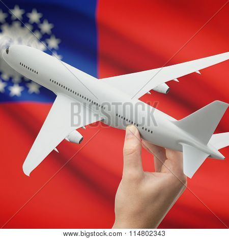 Airplane In Hand With Flag On Background - Burma