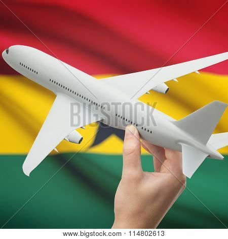 Airplane In Hand With Flag On Background - Ghana