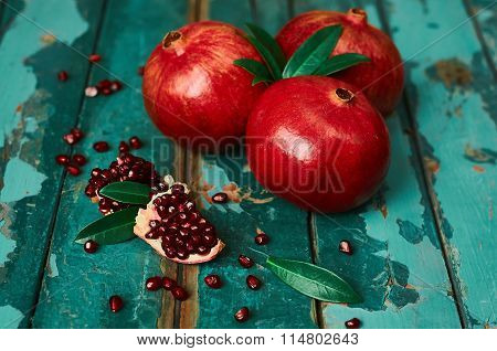 Pomegranate On The Old Wooden Background