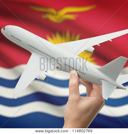 Airplane In Hand With Flag On Background - Kiribati