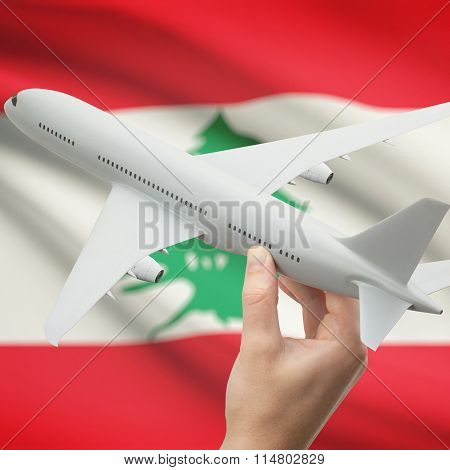 Airplane In Hand With Flag On Background - Lebanon