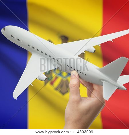 Airplane In Hand With Flag On Background - Moldova