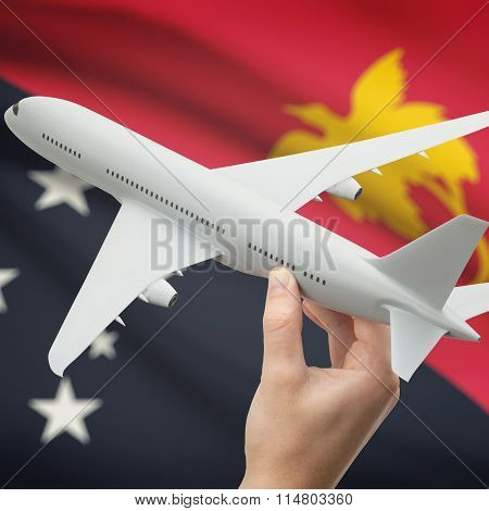Airplane In Hand With Flag On Background - Papua New Guinea