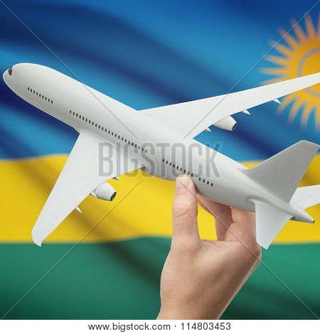 Airplane In Hand With Flag On Background - Rwanda