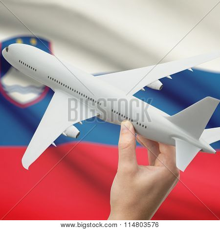 Airplane In Hand With Flag On Background - Slovenia