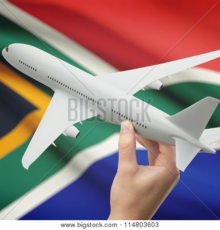 Airplane In Hand With Flag On Background - South Africa