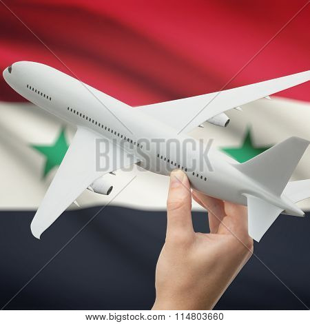 Airplane In Hand With Flag On Background - Syria