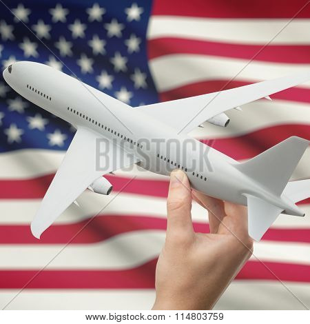 Airplane In Hand With Flag On Background - United States