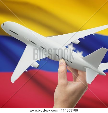 Airplane In Hand With Flag On Background - Venezuela