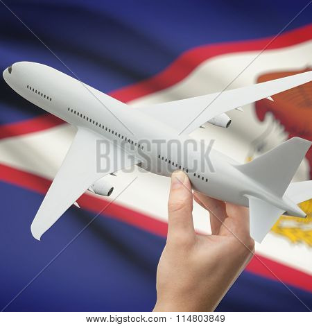 Airplane In Hand With Flag On Background - American Samoa
