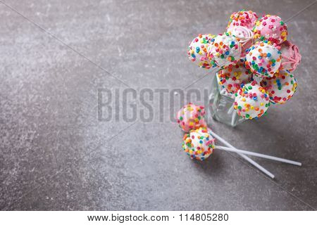 Cake Pops Can On Grey Slate Background.