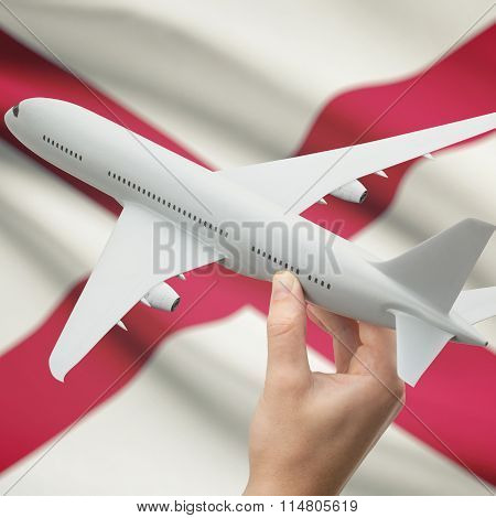 Airplane In Hand With Us State Flag On Background - Alabama