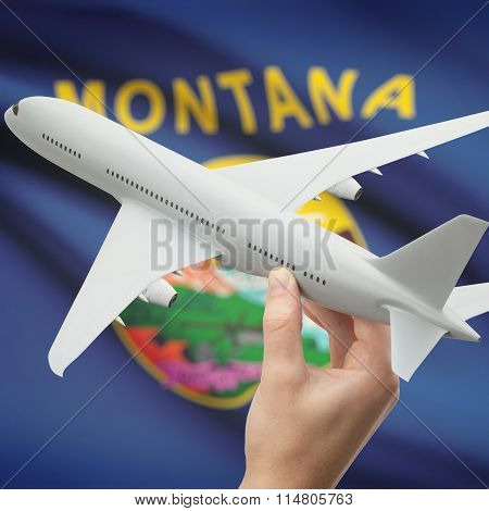 Airplane In Hand With Us State Flag On Background - Montana