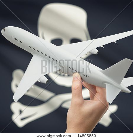 Airplane In Hand With Us State Flag On Background - Jolly Roger - Symbol Of Piracy