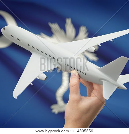 Airplane In Hand With Us State Flag On Background - South Carolina