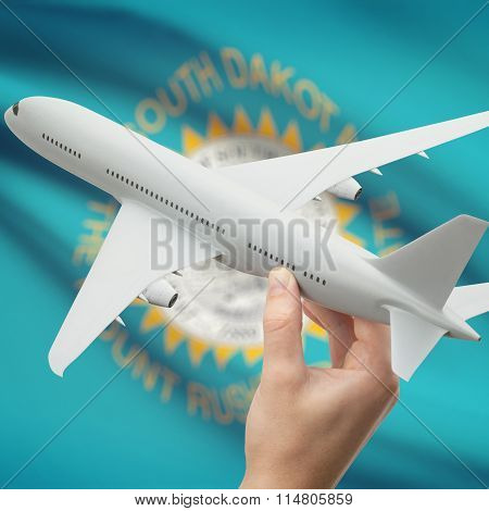 Airplane In Hand With Us State Flag On Background - South Dakota