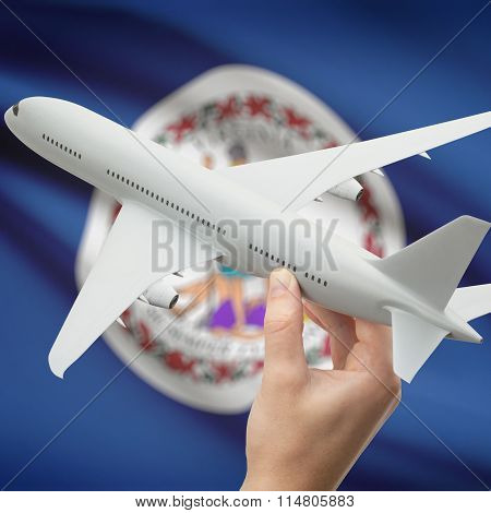 Airplane In Hand With Us State Flag On Background - Virginia
