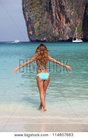 Beautiful woman in bikini enjoy walking on beach at Maya bay, Thailand