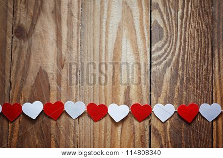 Red And White Ppaper Hearts On The Clothesline On  Wood Background