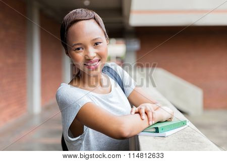 cute african college girl standing by passage
